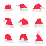 Red Santa Claus hats isolated on colorful background. Symbol of Christmas holiday. Vector santa hat set. Stock Images
