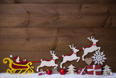 Red Santa Claus Sled With Reindeer, Snow, Christmas Decoration Stock Images