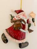Red santa claus tinplate xmas decoration. Red santa claus metallic xmas decoration on white background Stock Image