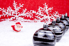 Red santa figure on red background. Red santa claus figure in snow on red background Royalty Free Stock Images