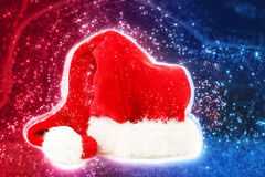 Red santa hat on abstract background Royalty Free Stock Photos