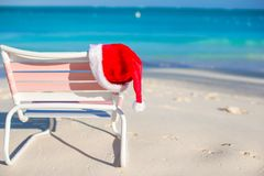 Red Santa hat on beach chair Royalty Free Stock Photos