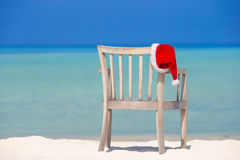Red santa hat on beach chair at tropical vacation Stock Images