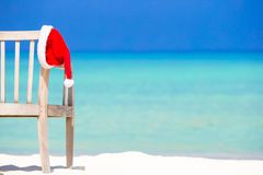 Red santa hat on beach chair at tropical vacation Stock Photos