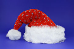 Red santa hat on blue Royalty Free Stock Photos