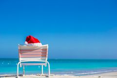 Red Santa hat on chair longue at sea shore Stock Images
