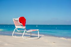Red Santa hat on chair longue at tropical beach Royalty Free Stock Photography