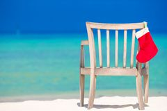 Red santa hat on chair at tropical white beach Stock Photography