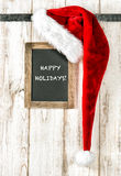 Red Santa hat and chalkboard. Christmas decoration Happy Holiday Stock Photo