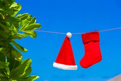 Red Santa hat and Christmas stocking hanging on Royalty Free Stock Image