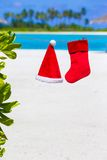 Red Santa hat and Christmas stocking hanging on Stock Photography
