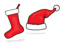 Red santa hat and christmas stocking Royalty Free Stock Photos