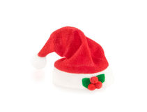 Red Santa hat with decoration on white. Royalty Free Stock Image