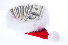 Red santa hat with dollars. On white Stock Photo