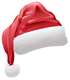 Red santa hat with fluffy white fur Stock Photos