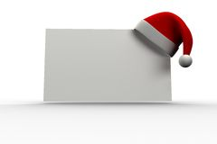 Red santa hat hanging on poster. On white background Stock Photography