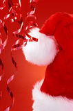 Red santa hat and streamers Royalty Free Stock Image