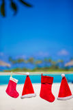 Red Santa hats and Christmas stocking hanging on Stock Images