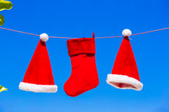 Red Santa hats and Christmas stocking hanging on Stock Image
