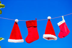 Red Santa hats and Christmas stocking hanging on Stock Photography
