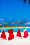 Red Santa hats and Christmas stocking hanging on Stock Photos
