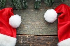 Santa hats with fir-tree branch stock photos