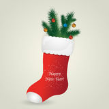 Red Santa's boot with christmas pine and balls Royalty Free Stock Photo