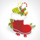 Red Santa's boot with giftbag Stock Photos