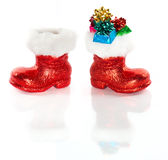 Red Santa's boot with gifts Stock Photos