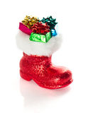 Red Santa's boot with gifts  on white Royalty Free Stock Images