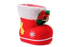 Red Santa`s shoe. Stuffed with Christmas presents over white background Royalty Free Stock Image