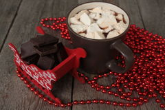 Red Santa's sleigh with chocolate, hot cocoa with marshmallows, Christmas decorations.  Christmas miracle soon Stock Photography