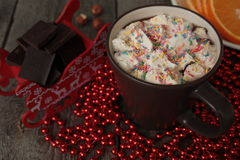 Red Santa's sleigh with chocolate, hot cocoa with marshmallows, Christmas decorations. Christmas miracle soon Royalty Free Stock Image