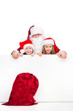 Red Santa sac on foreground isolated over white background Stock Image