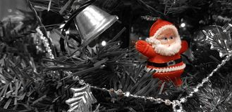 Red santa toy on Christmas tree stock photo