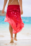 Red sarong. Beautiful red sarong blowing in wind on tropical beach Stock Photography