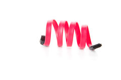 Red SATA cable twisted in spring Stock Images