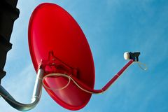 Red satellite dish with blue sky Royalty Free Stock Image