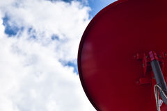 Red satellite dish with blue sky background Royalty Free Stock Image
