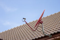 The Red satellite dish on the roof Royalty Free Stock Photography