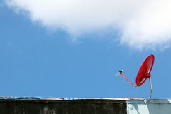 Red satellite on sunny blue sky Stock Images