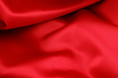 Red Satin. Piece of red satin fabric for a background texture Royalty Free Stock Photo
