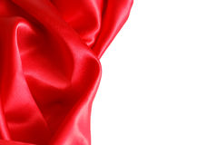 Red Satin. A red satin fabric over a white background with plenty of copyspace Royalty Free Stock Photos
