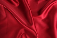 Red Satin. A background of a crumpled red satin cloth Stock Images