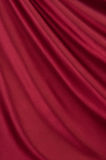 Red satin. Drape of beautiful red satin Royalty Free Stock Photography