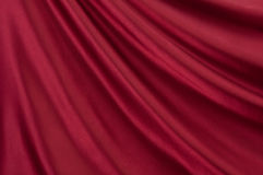 Red satin. Drape of beautiful red satin Stock Photo