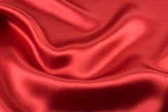 Red satin alpha. Scrunched up red satin fabric royalty free stock image
