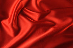 Red satin background Stock Images