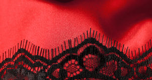 Red satin with black lace Royalty Free Stock Image
