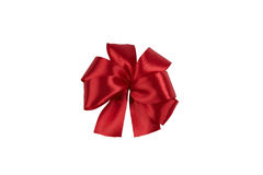 Red satin bow. Red satin bow flower shaped in the center of picture. Isolated on white Royalty Free Stock Images